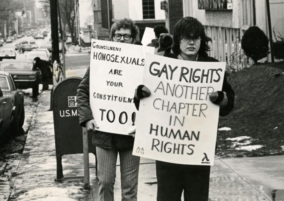 Protesters with signs at first  gay rights protest in Buffalo